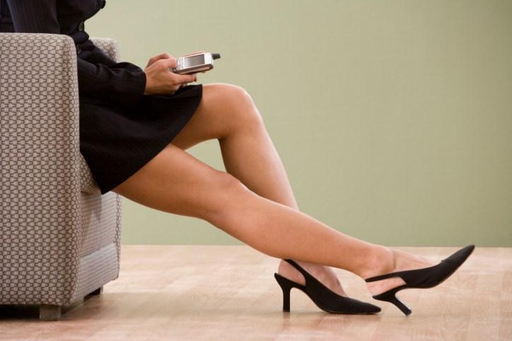 Bare legs of businesswoman wearing short skirt